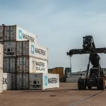 Reacher moving container